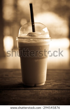 Iced coffee on table vintage style - stock photo
