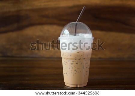 Iced coffee on the wooden background. - stock photo