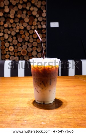 Iced coffee on wood table.