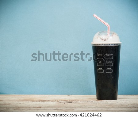 Iced coffee vintage background,Selective focus on paper cup - stock photo