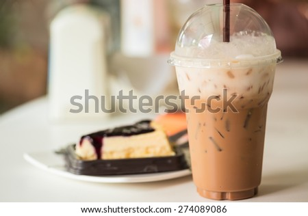 Iced coffee with blueberry cheese cake - stock photo