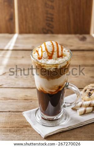 iced coffee with milk and caramel ice cream - stock photo