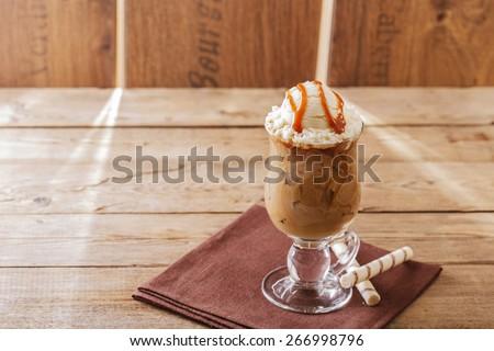 iced coffee with milk and ice cream caramel - stock photo