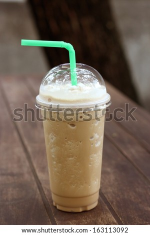 Iced coffee with straw in plastic cup isolated - stock photo