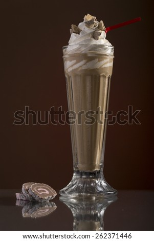 iced coffee with whipped cream and drinking straw for the menu card - stock photo