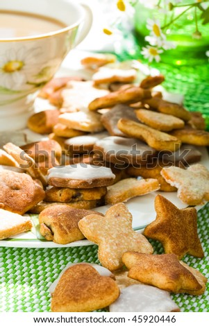 Iced cookies with a cup of tea in the background - stock photo
