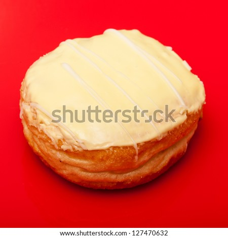 Iced Donught on a red studio background.
