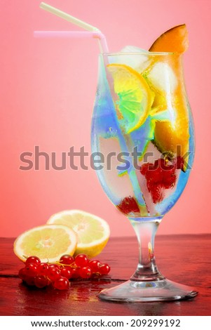 iced fruit cocktail over oink background - stock photo