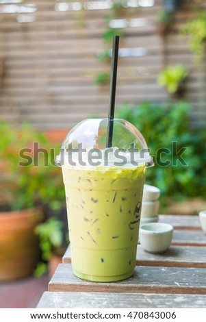 iced green tea milkshake on table
