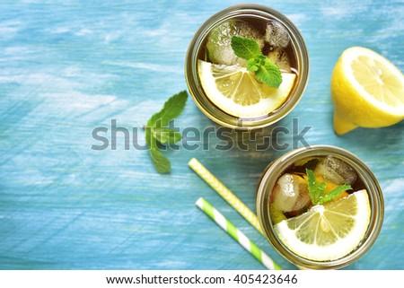 Iced lemon tea in a mason jar.Top view. - stock photo