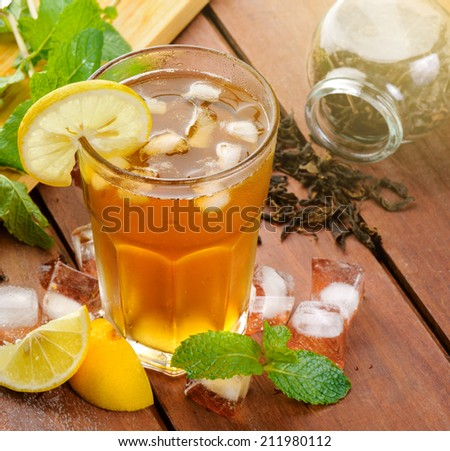 iced lemon tea with sliced lemon - stock photo