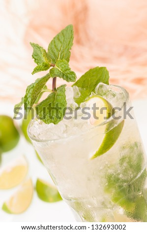 Iced Lime Mojito cocktail with a straw hat at the background - stock photo