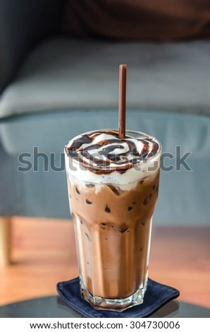 Iced Mocha Coffee in glass on the table - stock photo