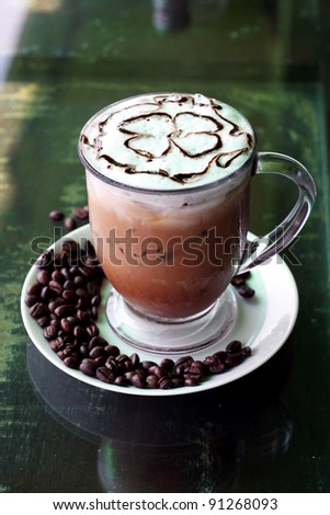 iced mocha on white disk with coffee bean - stock photo