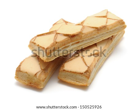 Iced puff pastry biscuits (sfogliatine glassate) isolated on white background with clipping path - stock photo