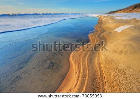 Iced shoreline of Lake Michigan near sunset, Saugatuck Dunes State Park, Michigan, USA - stock photo