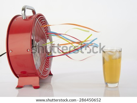 Iced tea and summer time fan to refresh - stock photo