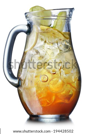 "Iced tea in the pitcher. A jug of cold tea mixed with lemonade (also known as ""half and half"") - stock photo"