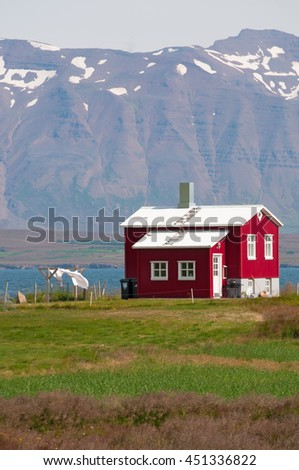 Iceland: a red wooden house in the Icelandic countryside on August 20, 2012. Colorful wooden houses are one of the main features of Nordic architecture