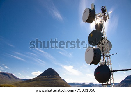 Iceland - cell antenas blue sky white clouds and sunlight - stock photo