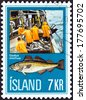 """ICELAND - CIRCA 1971: A stamp printed in Iceland from the """"Icelandic Fishing Industry """" issue shows landing catch and Atlantic Cod (Gadus morhua), circa 1971.  - stock"""