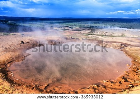 Iceland - geothermal activity near Geysir. Steaming hot springs. Filtered color style. - stock photo
