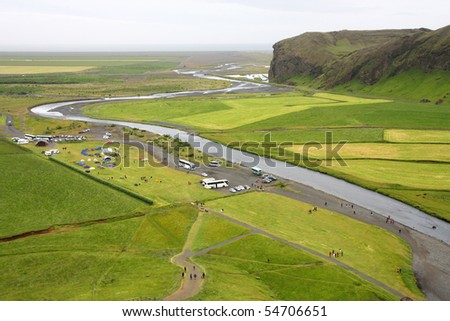 Iceland. Green valley of Skoga river, as seen from Skogafoss waterfall. Sudurland (South Iceland).
