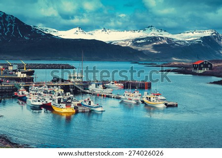 Iceland Harbor with Fishing Boats at Overcast Day - stock photo
