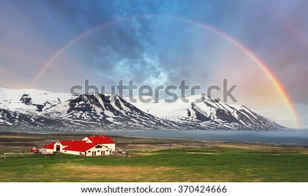 Iceland landspace mountain with rainbow - stock photo