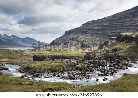 Iceland's Hengifoss Waterfall  - stock photo