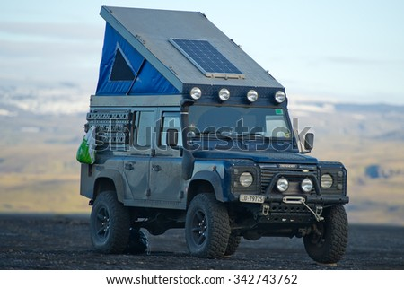 ICELAND - SEP 17: Land Rover Defender overland camper on Sep. 17, 2015 in Iceland. The iconic and legendary Land Rover Defender was issued in 1983. It goes out of production in Dec. 2015. - stock photo