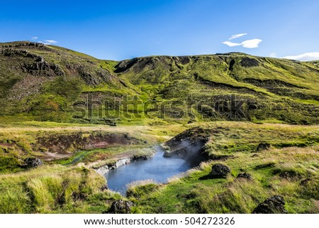 Icelandic landscape with a boiling water source