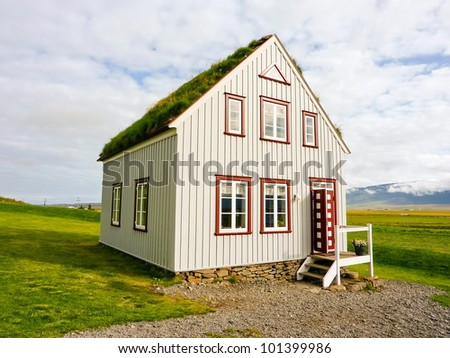 Icelandic traditional alone turf roof house in countryside - stock photo