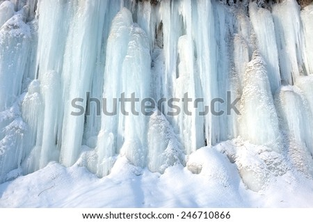 Icicle in wilderness, extremely frost. Light on the snow surface. - stock photo