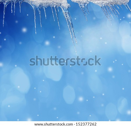 icicles and snow background with empty space - stock photo