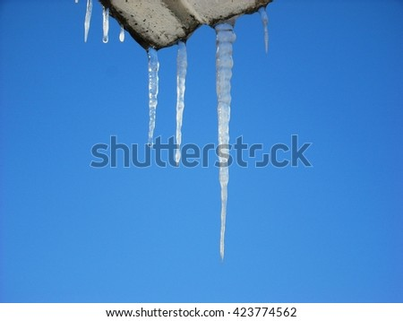 Icicles at daytime - stock photo