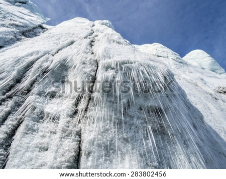Icicles on the glacier wall in the Arctic - Svalbard - stock photo