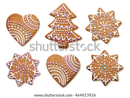 Icing decorated Christmas gingerbread cookies isolated on white background