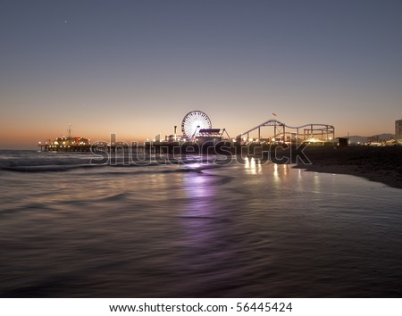 Icon Santa Monica Pier with a summer sunset. - stock photo