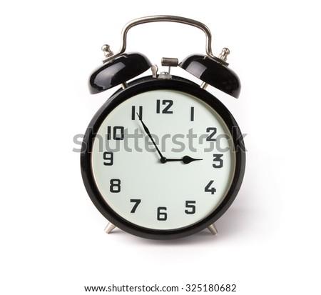 Iconic alarm clock isolated on white - stock photo