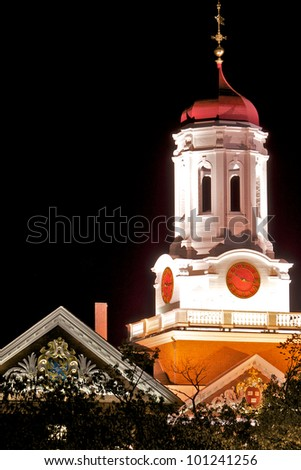 Iconic clock tower (Leverett Tower) at Dunster House shot from the Weeks footbridge, Harvard University, Cambridge, Massachusetts. - stock photo