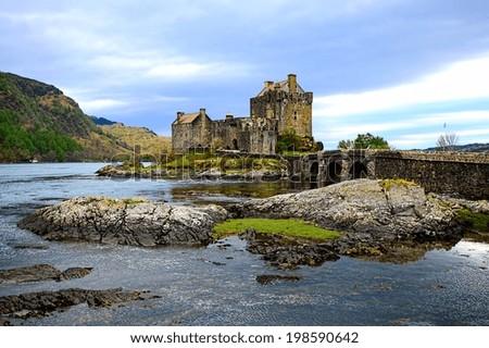 Iconic Eilean Donan Castle set in the lochs of Scotland - stock photo