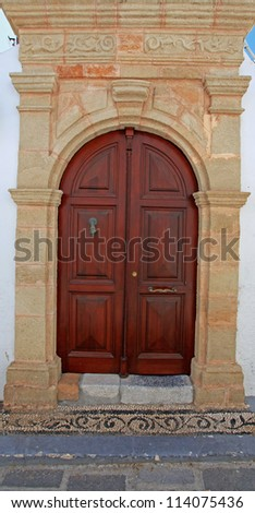 Iconic mansion door in the village of Lindos in Rhodes Greece