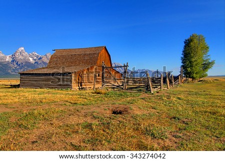 Iconic Mormon Row Barn which is a structure that is a part of Grand Tetons National Parks with the Teton Mountain Range in the background - stock photo
