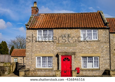 Iconic stone cottage in the village of Appleton Le Moors, which is located in the North York Moors National Park, North Yorkshire, England