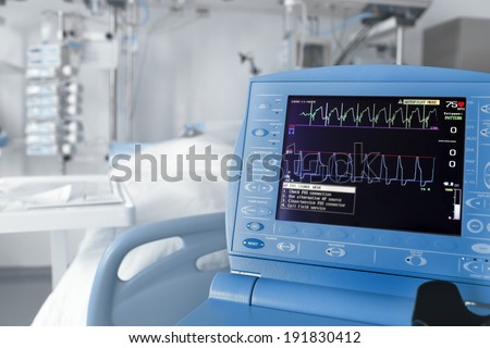 ICU room and cardiovascular monitor  - stock photo
