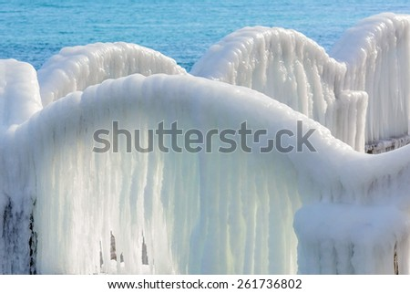 Icy Arch With Icicles On A Background Of Sea
