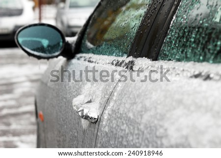 icy frozen car on parking - stock photo