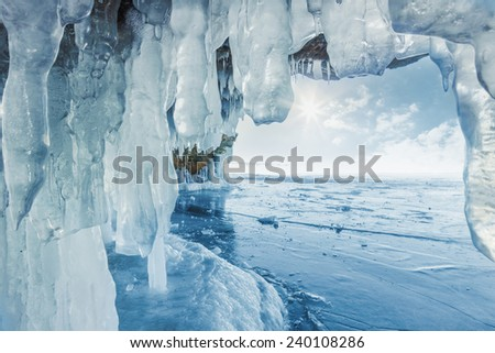 Icy frozen splash, icicles on the rocks - stock photo