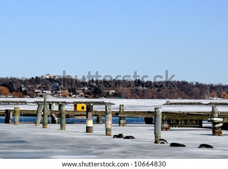 Icy morning at an empty marina in winter.
